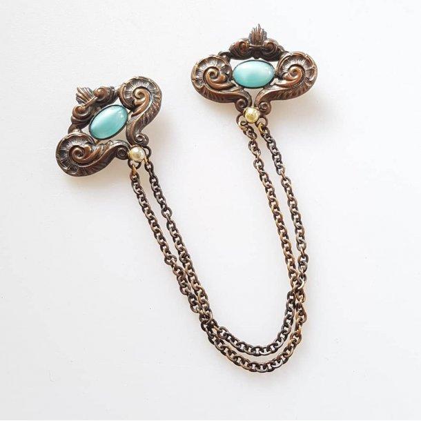 Vintage broche i bronze mad blå sten